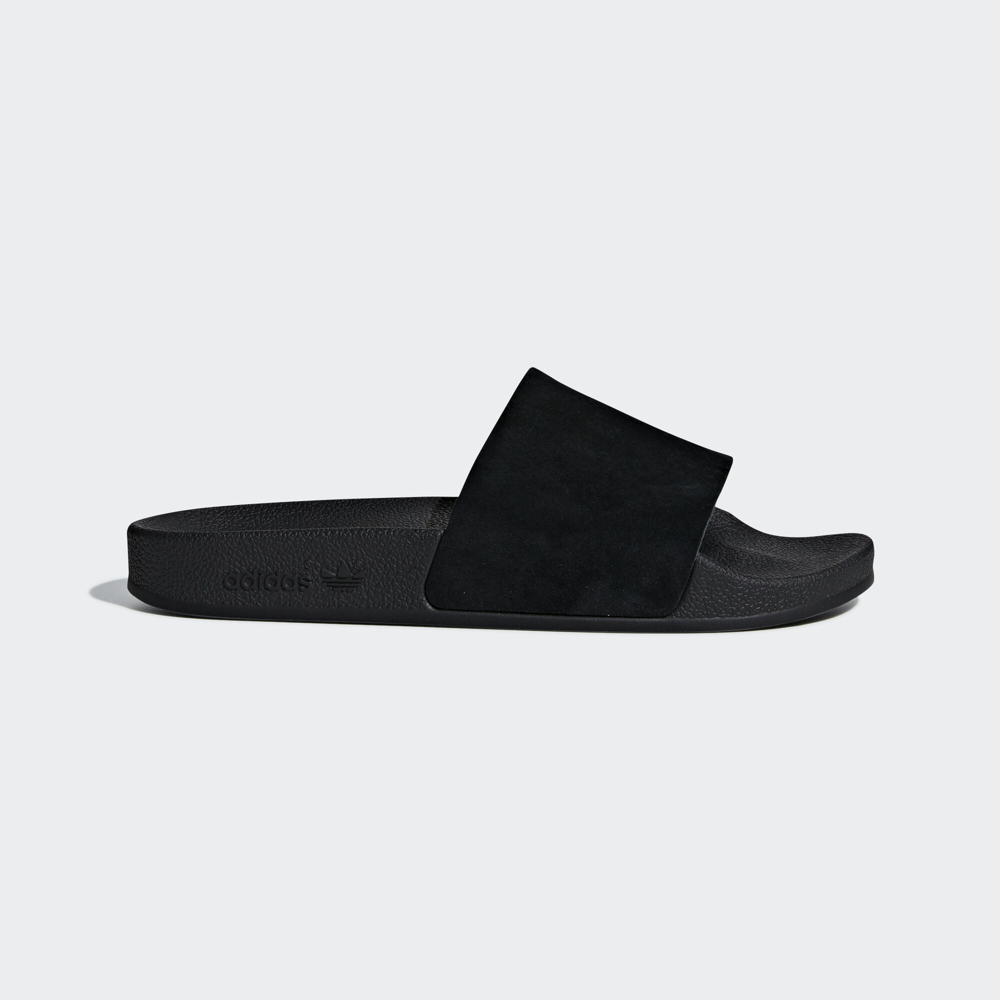 684d935a8e12c9 adidas - Adilette Slides Core Black   Core Black   Ftwr White DA9017. Women  Originals